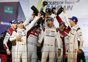 Porsche's LMP1 driver Mark Webber is doused with champagne by team-mates and fellow drivers.