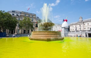London, England, Extinction Rebellion activists dye  the water in the fountains in Trafalgar Square