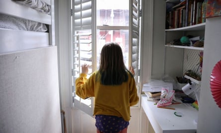 Lydia Hassebroek looks out at the view from her window in Brooklyn, New York.