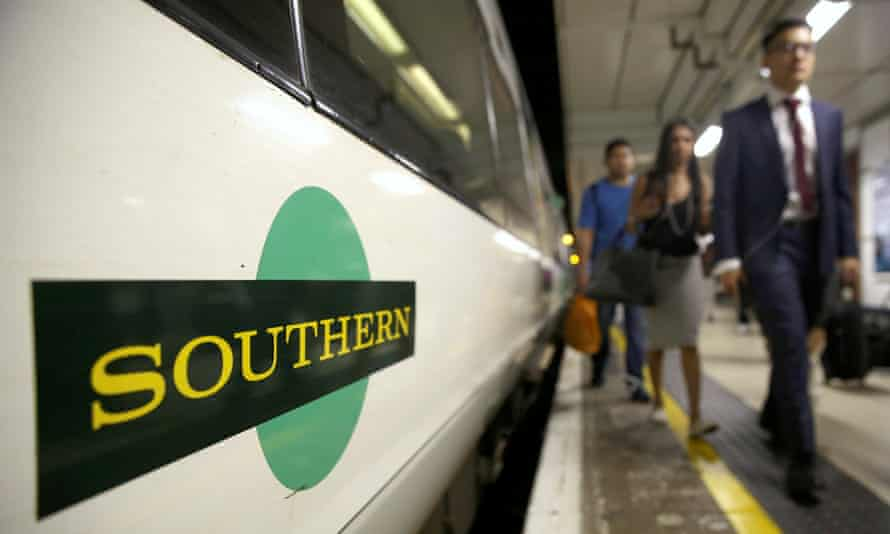 Passengers disembark a Southern train at Victoria Station in London