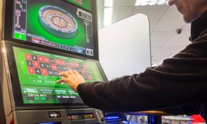 A man uses a fixed-odds Roulette machine.