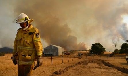 Rural Fire Service firefighter Trevor Stewart views a fire on 11 January in Tumburumba, Australia.
