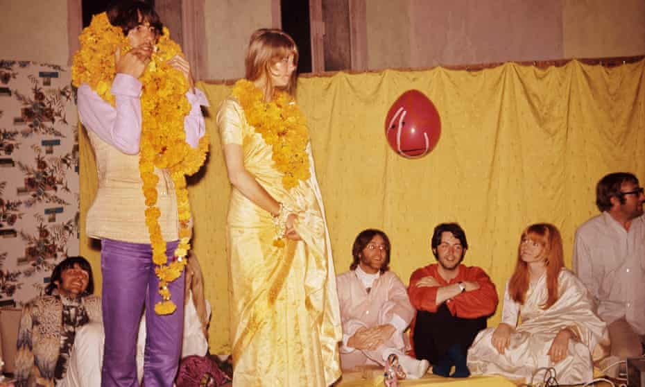 'In a way, the Beatles never left India' … George and Patti Harrison with garlands while the other members of the band look on.