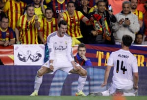Gareth Bale celebrates after scoring the winning goal in the final between Real Madrid and Barcelona in 2014.