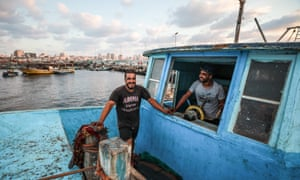 Said Abu Odeh (left), 24, and Mohammed Abu Odeh (right), 28, in a family-owned fishing boat in Gaza.