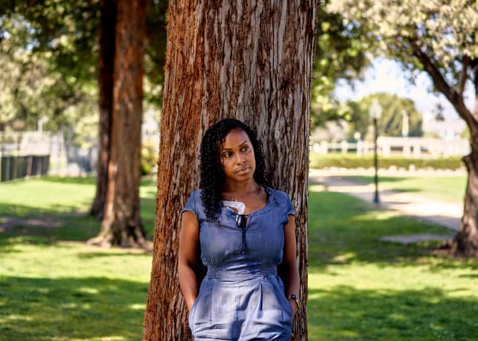 Ashanti Daniel, 40, a former nurse, poses for a portrait at a park in Beverly Hills.