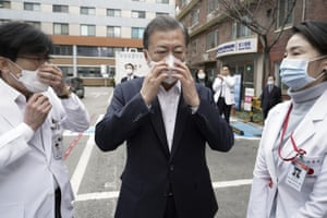 The South Korean president, Moon Jae-in, wears a mask during a visit to the National Medical Centre in Seoul