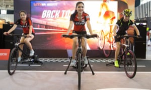 Models show bicycles during the Asia Bike Trade Show in Nanjing at the weekend.