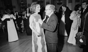 Lee Radziwill dances with Truman Capote at his black and white ball in New York in 1966.