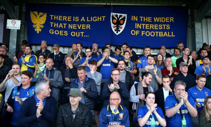 AFC Wimbledon fans with a banner referring to the 2002 report at a Carabao Cup game against MK Dons in August 2019