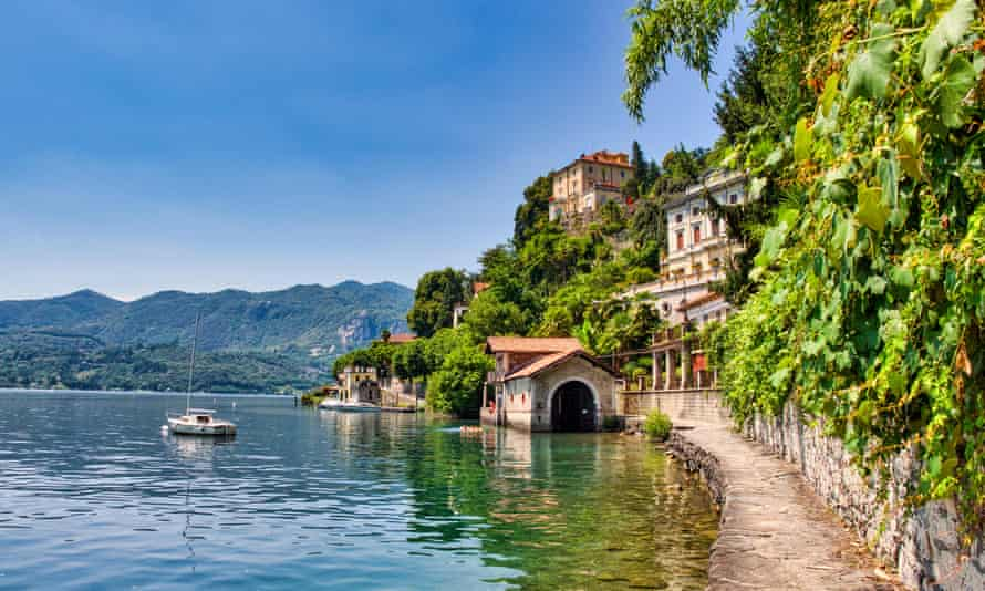 Cobblestone path bordering Lake Orta that leads hikers to the village of Orta San Giulio on Lake Orta, Italy.