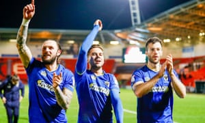 AFC Wimbledon's Callum Kennedy, Harry Forrester and Jonathan Meades celebrate after the draw at Doncaster that secured their League One status