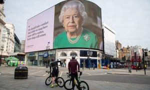 An image on a hoarding in London of the Queen broadcasting her message