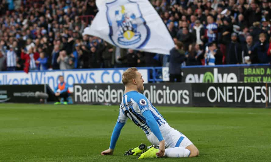 Alex Pritchard celebrates after giving Huddersfield the lead.