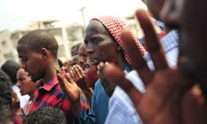 Somalis pray for victims of a massive al-Shabaab truck bomb attack in Mogadishu in October 2017.