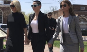 Rose McGowan, flanked by lawyers Jennifer Robinson, left, and Jessica Carmichael, right, outside the Loudoun County courthouse in Leesburg, Virginia, on Thursday.