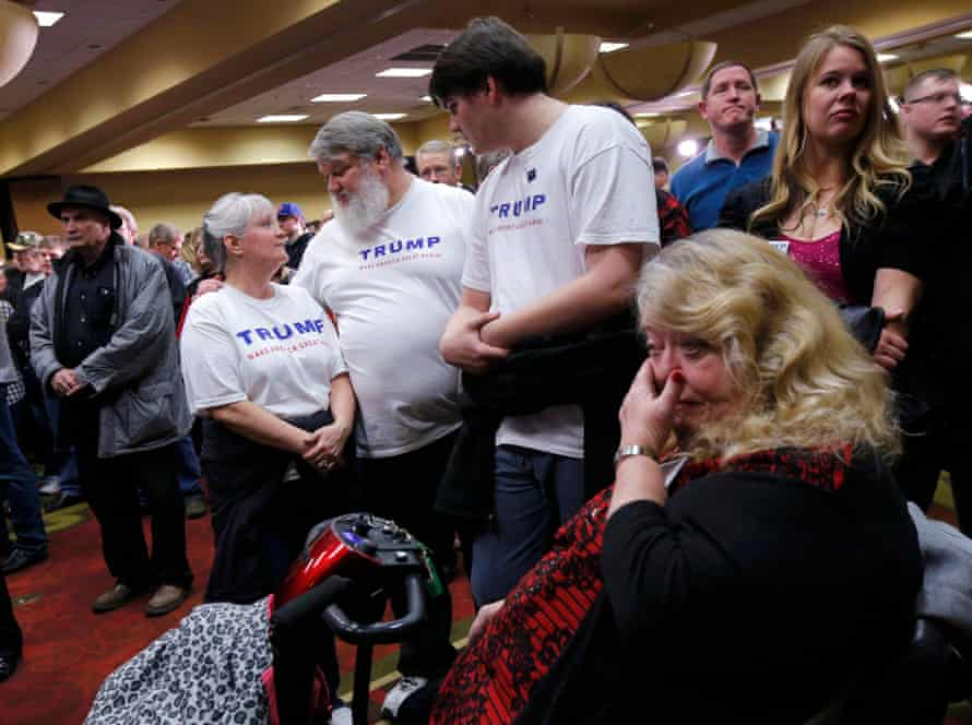 Trump react at a post-caucus rally in Des Moines.