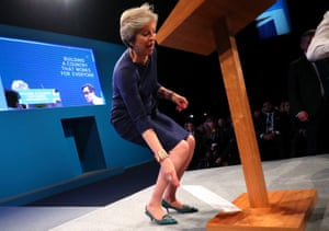 Theresa May discards a fake P45 termination of employment letter she was handed by a delegate. The British prime minister was speaking at the Conservative party conference in Manchester