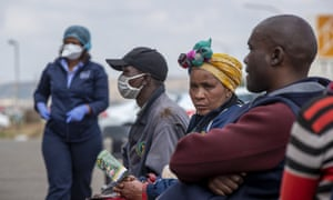 People await Covid-19 screening and testing in Lenasia, South Africa.