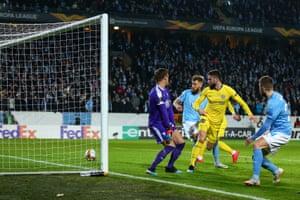 Olivier Giroud flicks the ball home from close range.