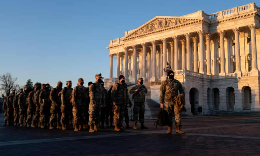 Members of the National Guard outside the US Capitol as the House debates a resolution calling on Mike Pence to invoke the 25th amendment, removing President Trump from office.