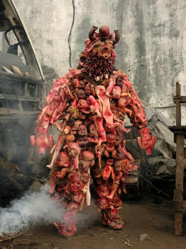 Shaka Fumu Kabaka in his costume, Matshozi 6 Jours (Six Days of Tears), made from dolls found in rubbish dumps or in the streets. The work is to honour the victims of the six day war in his hometown of Kisangani.