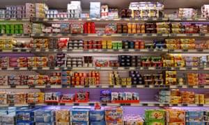 shelf of yoghurt products in supermarket