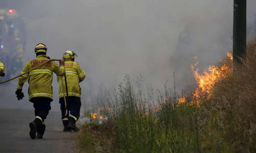 Firefighters work on a controlled burn in Koorainghat, South of Taree on Monday.