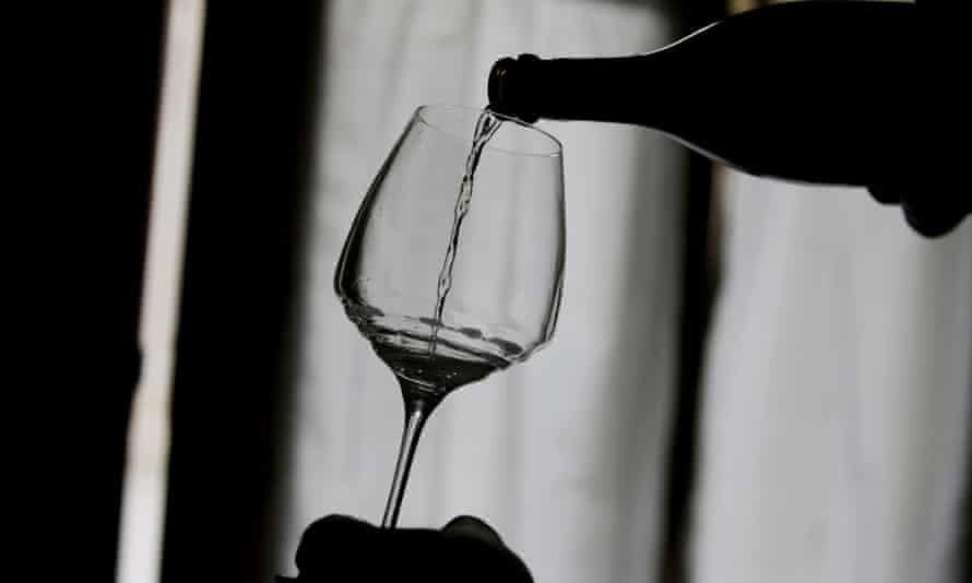 Silhouette of wine being poured into glass