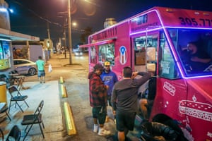 Patrons stand outside El Bori, a popular food truck serving Puerto Rican cuisine, in Miami.