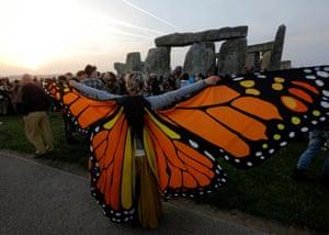 A reveller wearing butterfly wings