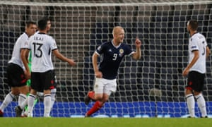 Steven Naismith celebrates scoring the second for Scotland.