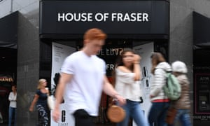 Pedestrians pass a House of Fraser store in London