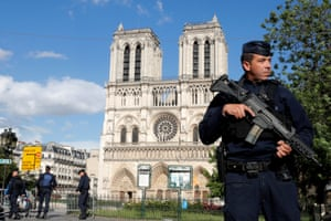 French police and gendarmes stand at the scene of a shooting incident near the Notre Dame Cathedral in Paris.