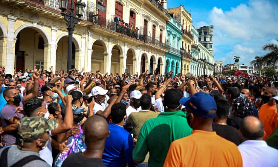 People take part in a demonstration against the government of the Cuban president, Miguel Díaz-Canel in Havana, on Sunday.