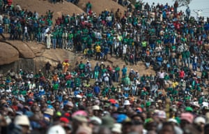Miners gather during a rally on the fourth anniversary of the Marikana massacre