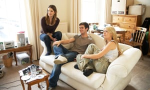 Three young people sitting on a sofa