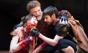 Flora Spencer-Longhurst (Lavinia), William Houston (Titus) and Dyfan Dwyfor (Lucius) in Titus Andronicus at Shakespeare's Globe in 2014.