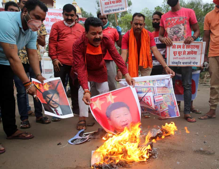 Activists stage a protest against China in Bhopal, India, on Tuesday. Public opinion may make calming tensions difficult.