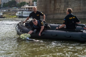 A wreath is placed in the Danube in memory of the victims of the capsized Hableány sightseeing boat in Budapest, Hungary