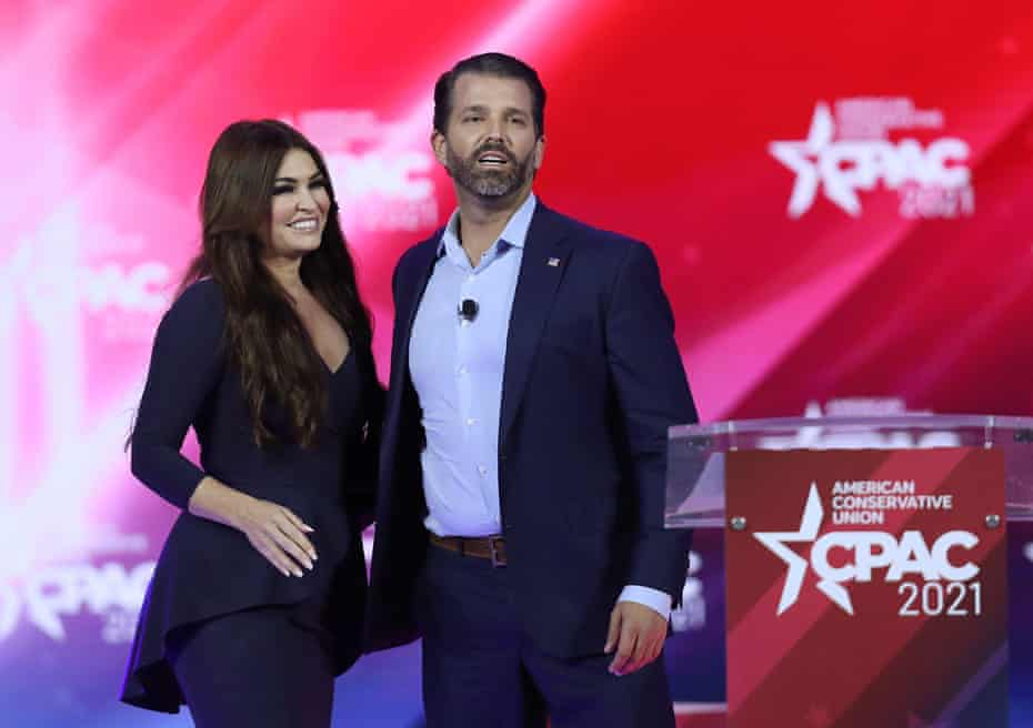 Donald Trump Jr with his partner Kimberly Guilfoyle at CPAC on Friday. Trump attacked Biden's reversal of his father's immigration policies and said: 'Guess who gets hurt? Our low-wage earners.'
