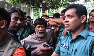 Shahidul Alam on 6 August surrounded by police for an appearance in a Dhaka court.