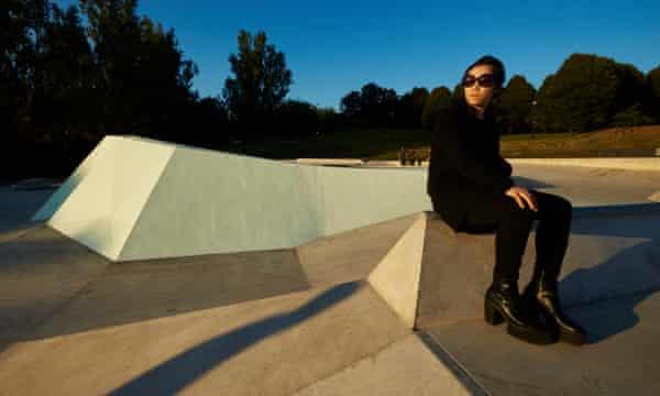 Artist Koo Jeong A sitting on her fluorescent skatepark in Everton Park, Liverpool.