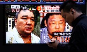 Grand champion Harumafuji (left) and junior wrestler Takanoiwa