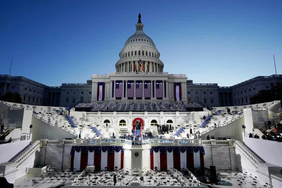 The US Capitol and stage are lit at sunrise ahead of the inauguration of Joe Biden on Wednesday in Washington DC.