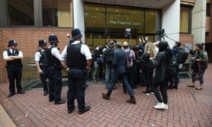 People gather outside Kensington town hall where the council leader adjourned a meeting after journalists were admitted.