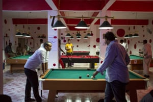 Mohamed and his cousin Zak play pool
