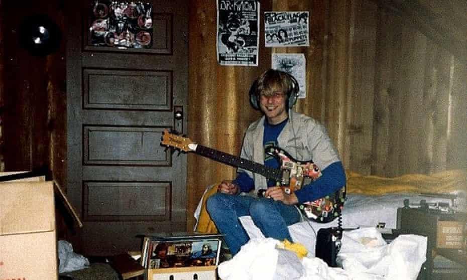 Nirvana's Kurt Cobain plays guitar in his childhood home in Aberdeen, Wash.