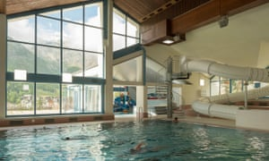 Indoor pool with large window view of mountains, Wellness Hostel 4000, Switzerland.