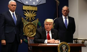Donald Trump signs an executive order banning refugees and travelers from Muslim countries from entering the US.